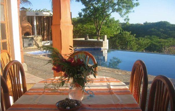 Casa Mariposa pool side dining